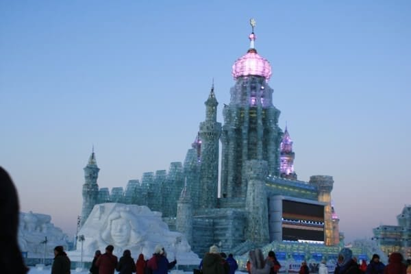 ice-and-snow-world-dusk - Harbin Ice Festival and Freezing our Butts Off! by thewoksoflife.com