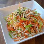 Cold tofu salad with carrots and peppers