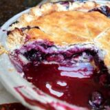 blueberry pie with slice cut out