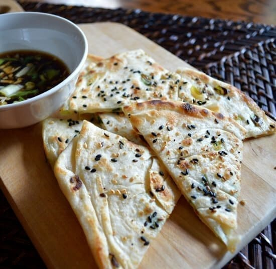 Scallion pancakes with sesame seeds and dipping sauce