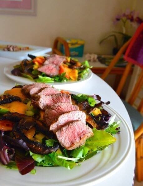 two plates of steak salad