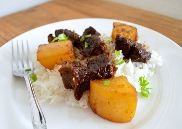 Braised beef with daikon radish over rice