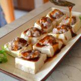 Pouring sauce over stuffed tofu