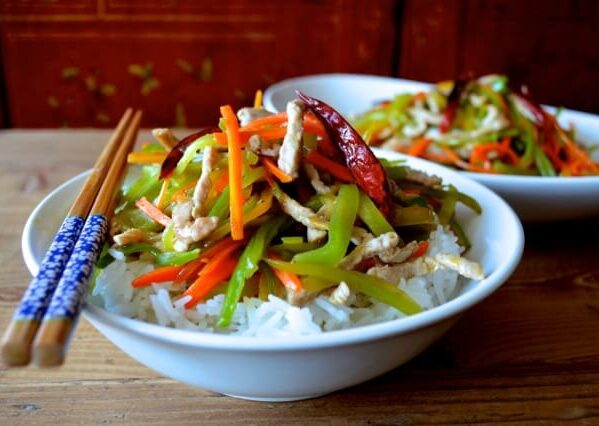 Bowl of Pork and vegetable stir-fry over rice