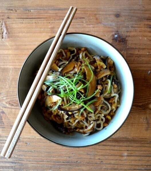 Mushroom noodles in bowl with chopsticks