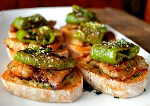 Pinchos with pork belly and peppers