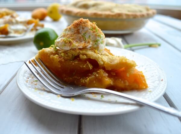 Slice of mango pie with whipped cream