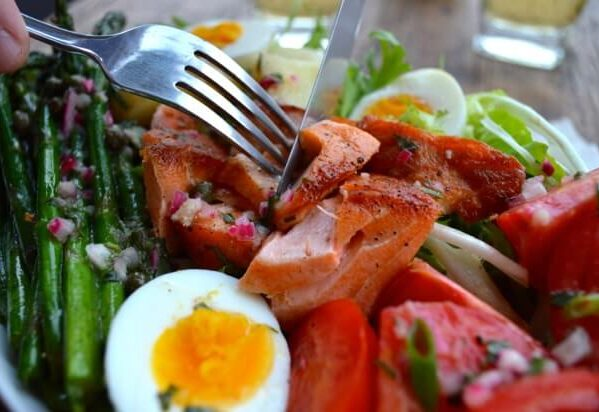 Knife and fork in salmon salad