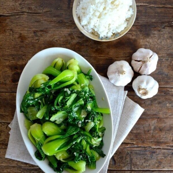 Stir-fried bok choy with bowl of rice