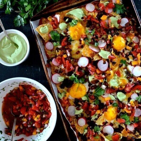 Huevos rancheros nachos with avocado crema and salsa