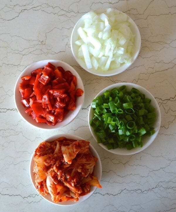 Chopped onions, bell pepper, scallion, and kimchi