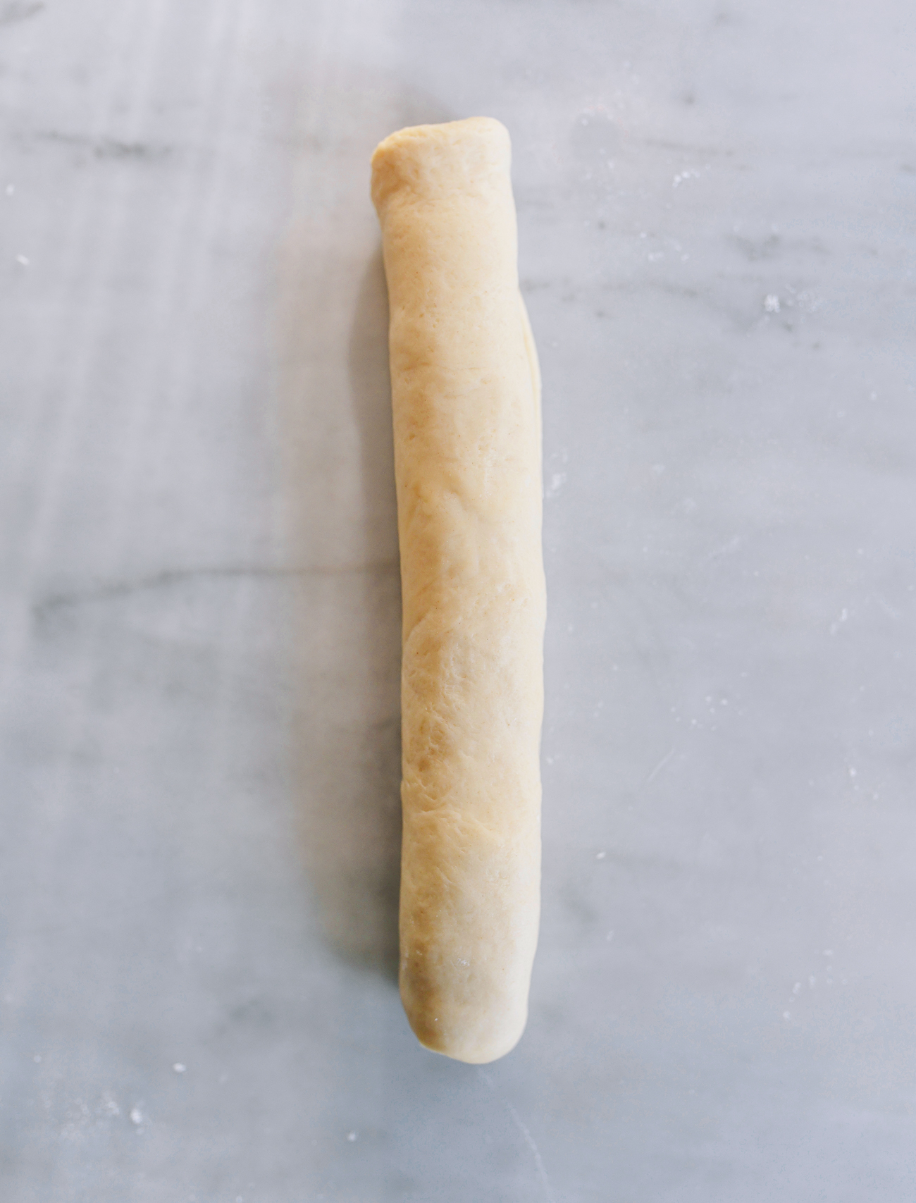 Rolled cigar of dough