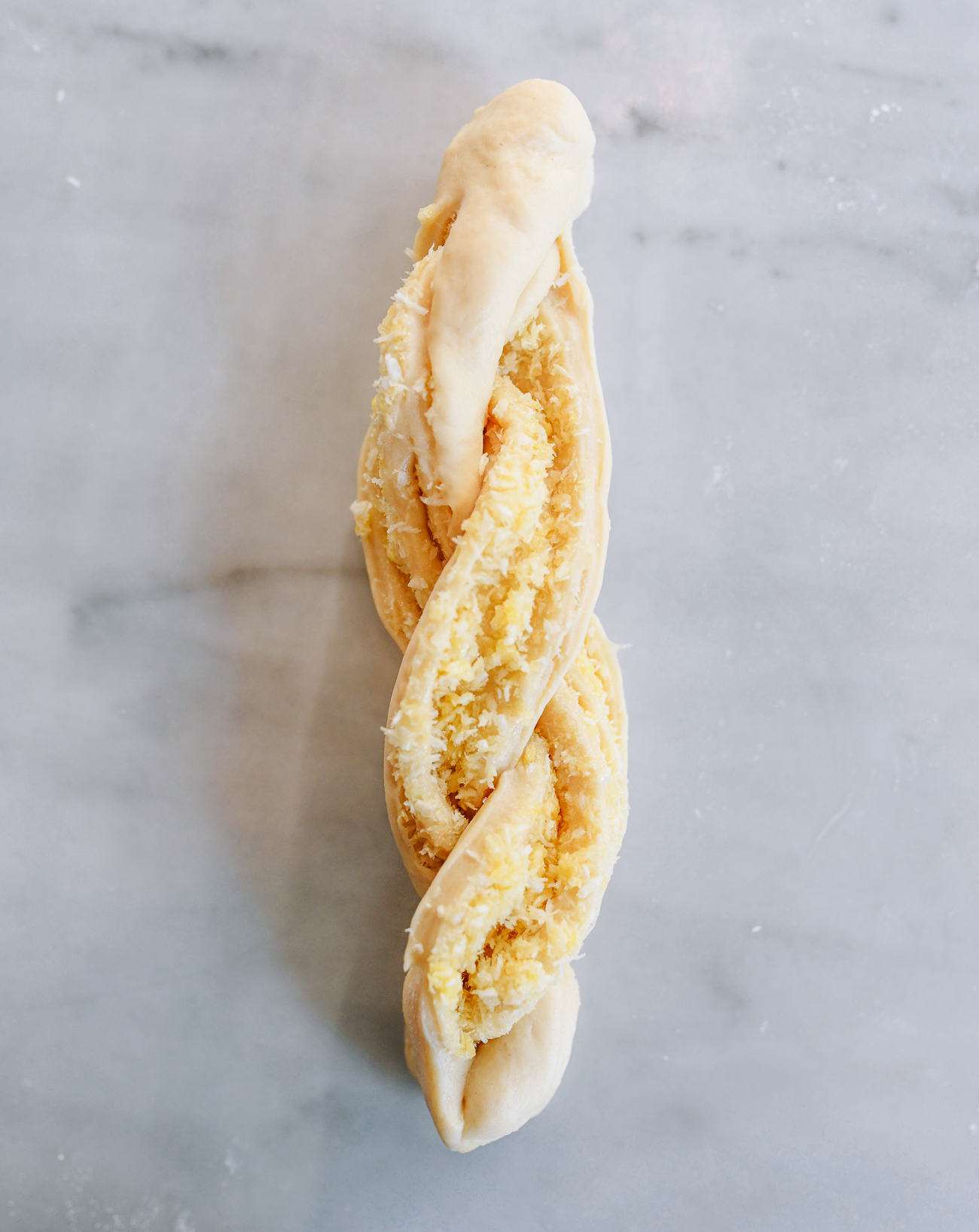 Twisted filled coconut dough