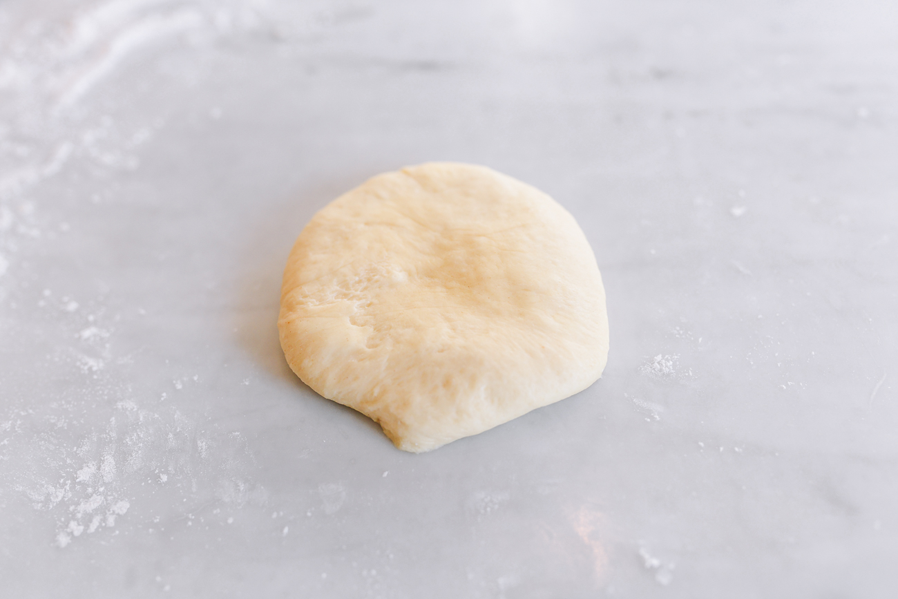Even dough disc before shaping