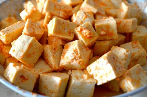 Firm tofu cubes coated in Sriracha and Honey by thewoksoflife.com