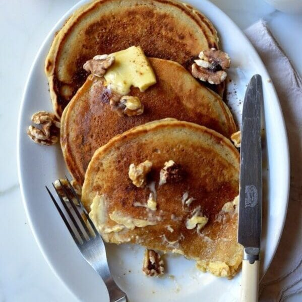 Apple cider pancakes with butter and walnuts