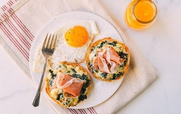 Kale prosciutto english muffin melts with fried egg and orange juice