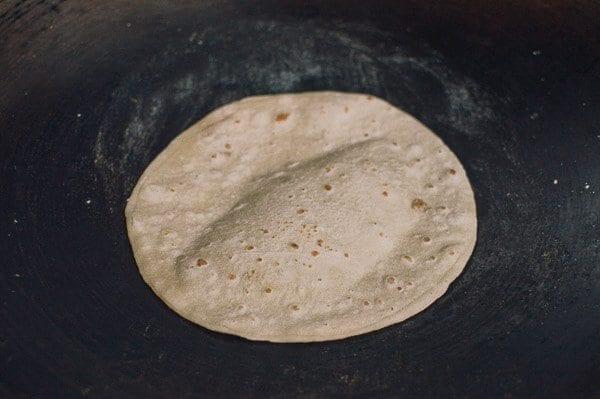 Cooking Chinese mandarin pancakes in wok, by thewoksoflife.com