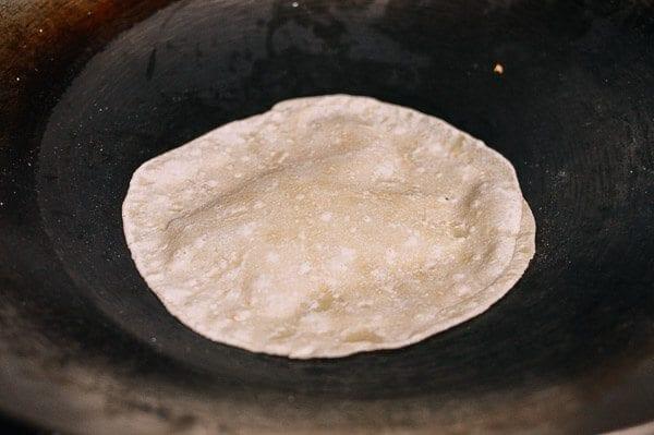 Cooking Mandarin Pancakes in wok, by thewoksoflife.com