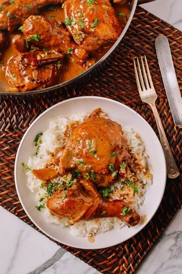 Chicken Adobo served over rice, by thewoksoflife.com