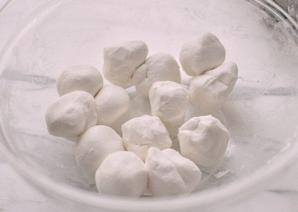 Tang Yuan (Sweet Rice Balls with Black Sesame Filling), by thewoksoflife.com