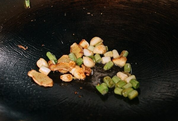 3 scallions, white and green parts separated