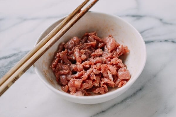 Marinating thinly sliced pork, by thewoksoflife.com