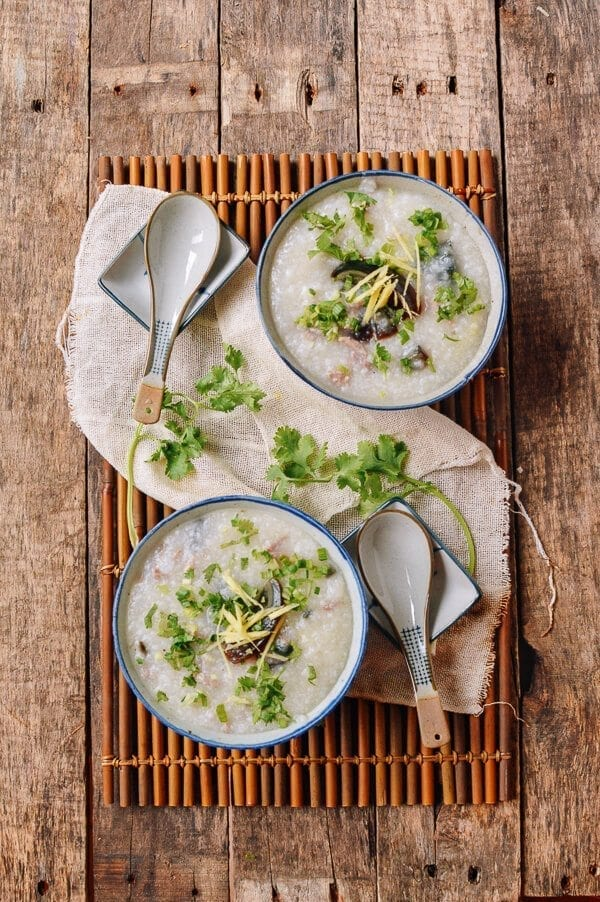 Cantonese congee with pork, thousand year old egg, ginger, and cilantro, by thewoksoflife.com