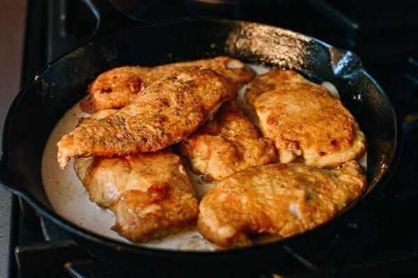 Adding chicken to chicken francese sauce, by thewoksoflife.com