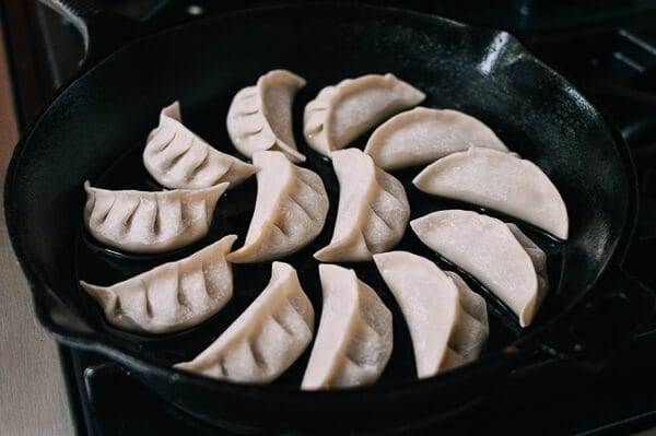 Dumplings in cast iron skillet, thewoksoflife.com