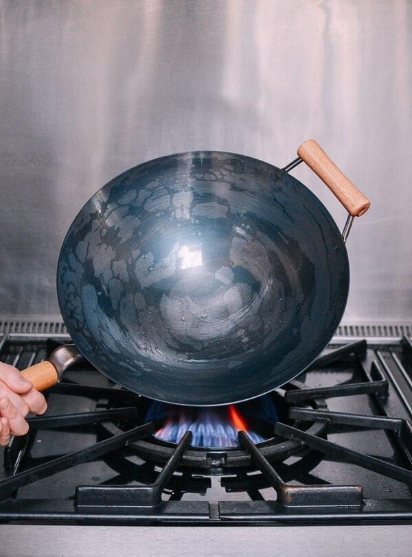 Drying a wet wok over heat