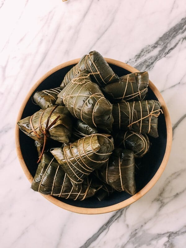 Wrapped Cooked zongzi (Sticky Rice Dumplings), by thewoksoflife.com