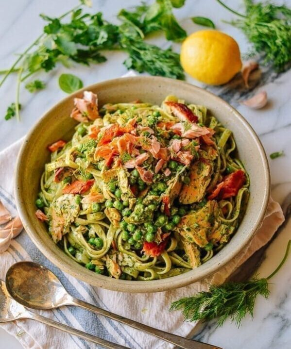 Bowl of fettuccini with green goddess, peas, and salmon