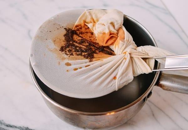 Hong Kong Milk Tea filtering tea through pantyhose, by thewoksoflife.com