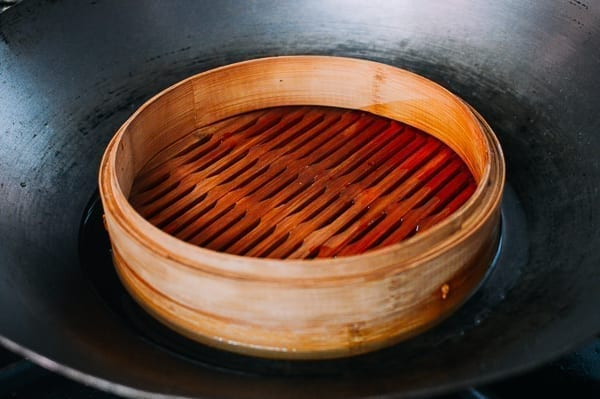 Bamboo Steamer Base in Wok with Water, by thewoksoflife.com