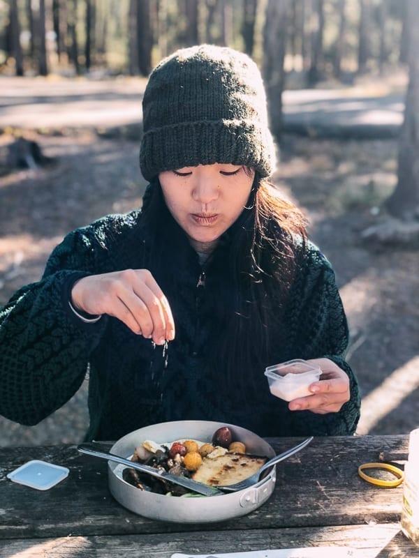 Sprinkling salt on camp breakfast
