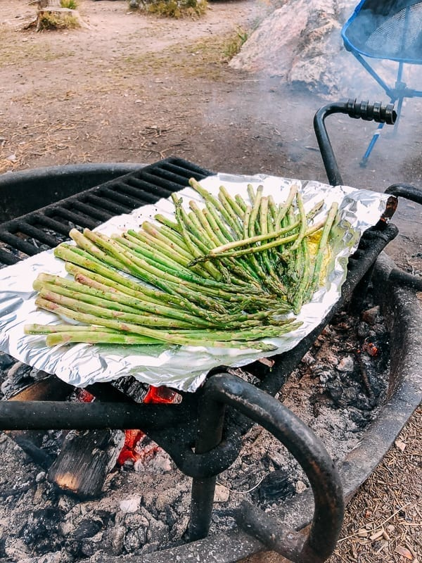 Grilling asparagus over campfire, thewoksoflife.com