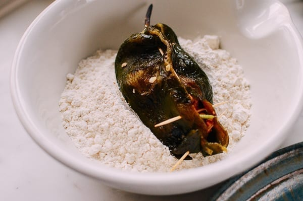 Dredging peppers in flour, thewoksoflife.com
