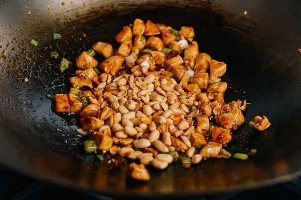 Adding peanuts to kung pao chicken, thewoksoflife.com