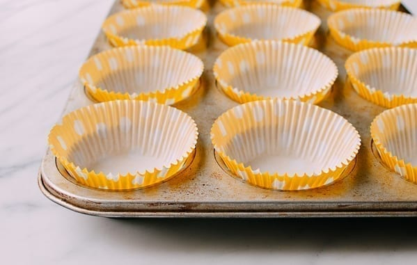 Muffin tin lined with paper cups, thewoksoflife.com