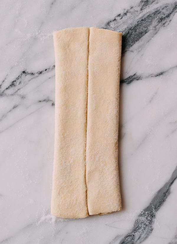 Folding puff pastry to make palmiers, thewoksoflife.com