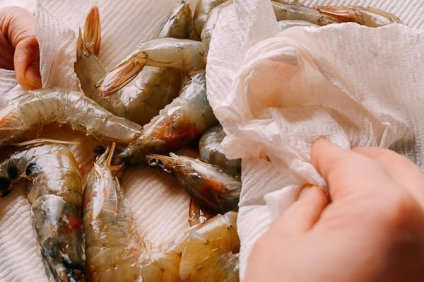 Patting shrimp dry with paper towel, thewoksoflife.com