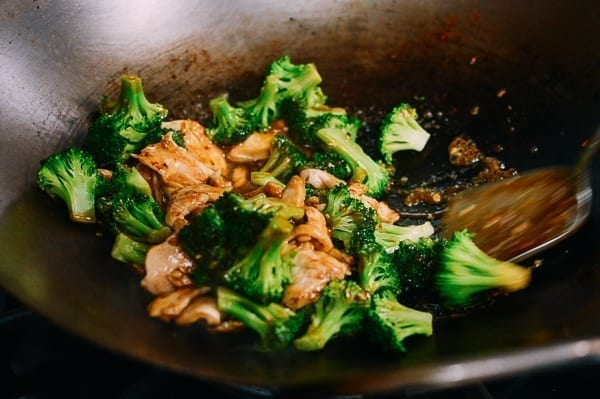 Stir-frying Chinese chicken and broccoli, thewoksoflife.com