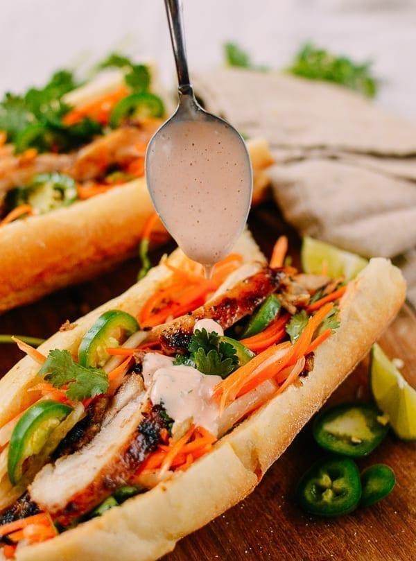Spooning Sriracha Mayo on Banh Mi, thewoksoflife.com