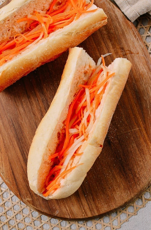 Adding pickled carrots and daikon to banh mi, thewoksoflife.com