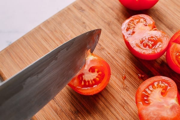 Removing stem from tomato, theewoksoflife.com