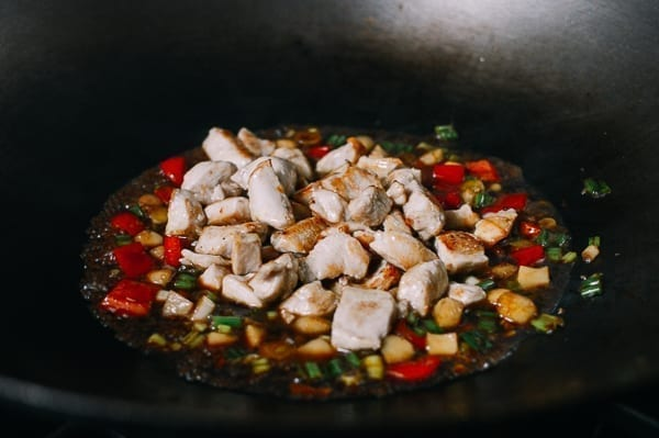 Adding chicken to the wok, thewoksoflife.com