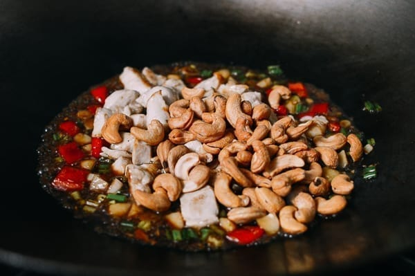 Adding cashews to stir-fry, thewoksoflife.com