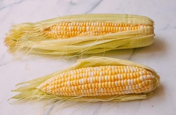 Two ears of bi-color sweet corn, thewoksoflife.com