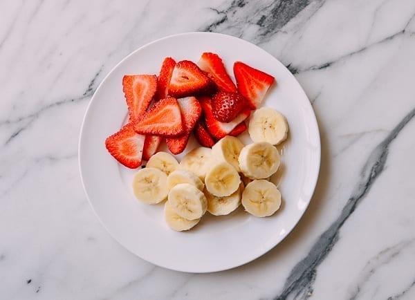 Sliced strawberries and bananas, thewoksoflife.com
